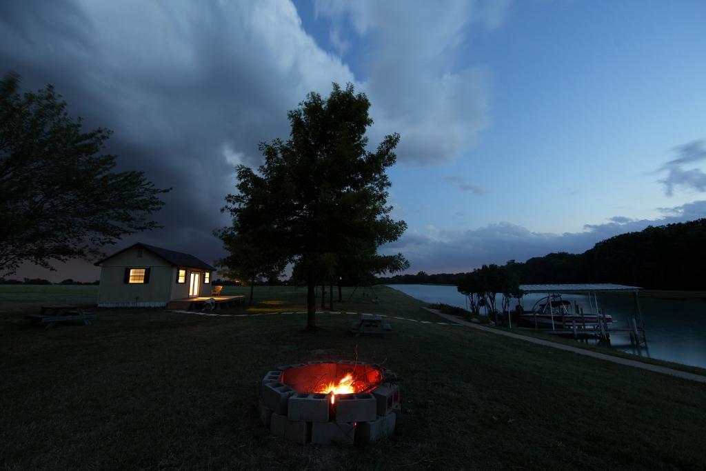 cabin and lake at night